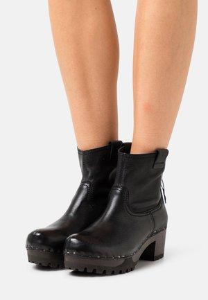 INKEN  - Platform ankle boots - black