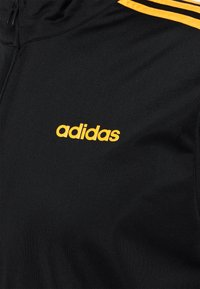 adidas Performance - Training jacket - black/active gold - 2