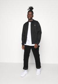 Carhartt WIP - MADISON JACKET  - Summer jacket - black - 1