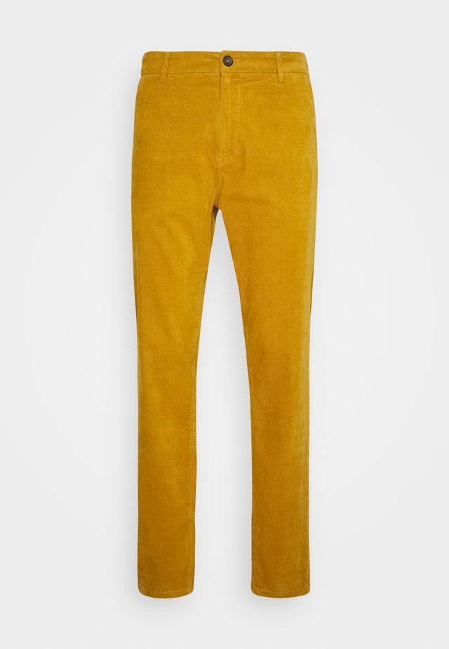 CORD TROUSERS - Pantalon classique - dark yellow