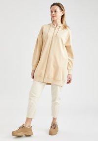 DeFacto - Zip-up hoodie - beige - 1