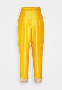 MANÉ - AMARA TROUSERS - Trousers - mustard - 1