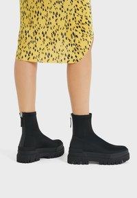 Bershka - Platform ankle boots - black - 1