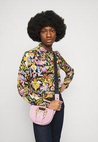 Versace Jeans Couture - CROSSBODY - Handbag - pink - 0