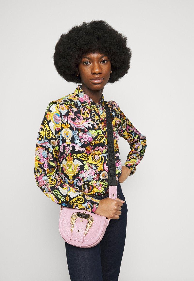 Versace Jeans Couture - CROSSBODY - Handbag - pink