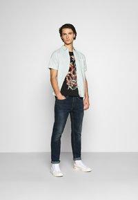 Levi's® - 502™ TAPER HI BALL - Jeans Tapered Fit - med indigo - 1