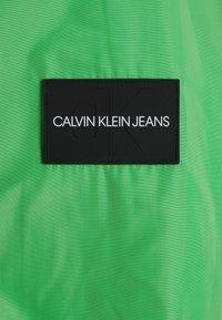 Calvin Klein Jeans - BLOCKED ZIP THROUGH JACKET - Summer jacket - andean toucan/black - 2