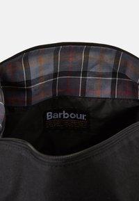 Barbour - EADAN HOLDALL UNISEX - Weekend bag - black - 3