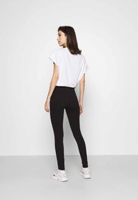 Hollister Co. - HOLIDAY GRAPHIC  - Leggings - Trousers - black side tape - 2