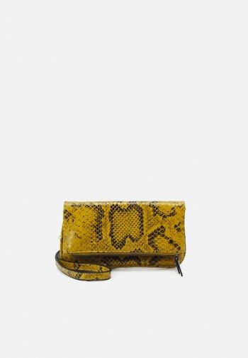 ALOE XS - Across body bag - dijon
