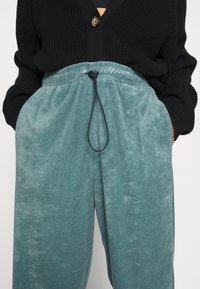 Topshop - TOWLLING JOGGER - Tracksuit bottoms - ice blue - 5