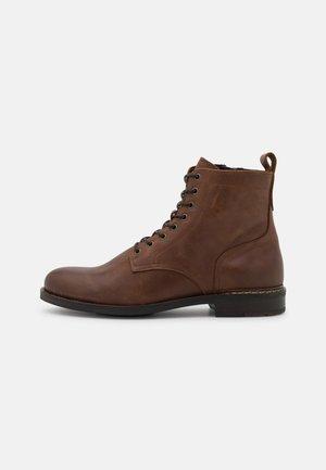 SAMI  - Lace-up ankle boots - cognac