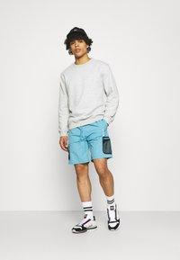 adidas Originals - UNISEX - Shorts - hazy blue - 1