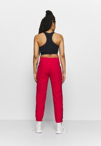Champion - ELASTIC CUFF PANTS ROCHESTER - Pantalones deportivos - red - 2