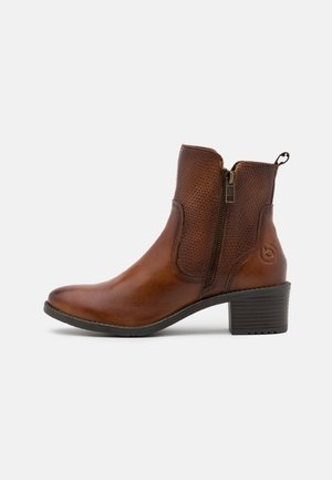 RUBY - Classic ankle boots - cognac