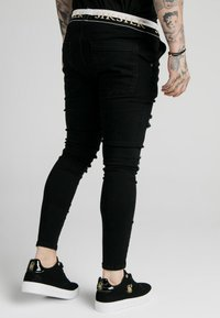 SIKSILK - SIKSILK DELUXE LOW RISE - Jeans Skinny Fit - black - 2