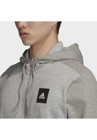adidas Performance - MUST HAVES FULL-ZIP STADIUM HOODIE - Sudadera con cremallera - grey