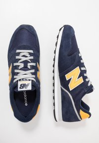 New Balance - 373 - Sneakersy niskie - blue/yellow - 1