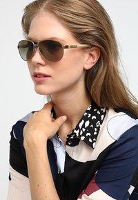 RALPH Ralph Lauren - Sunglasses - brown gradient - 1