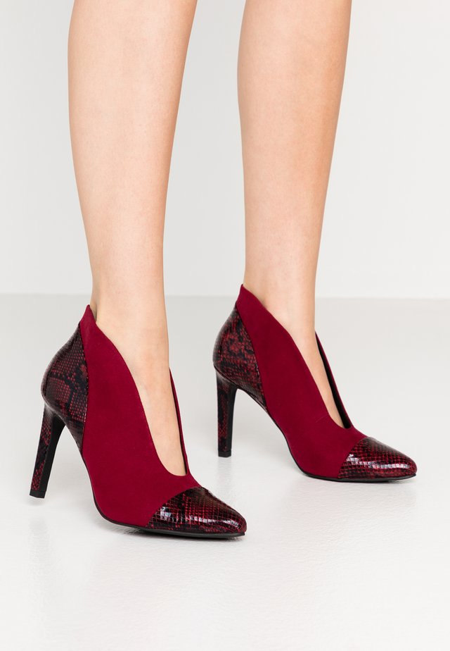 High heeled ankle boots - chianti