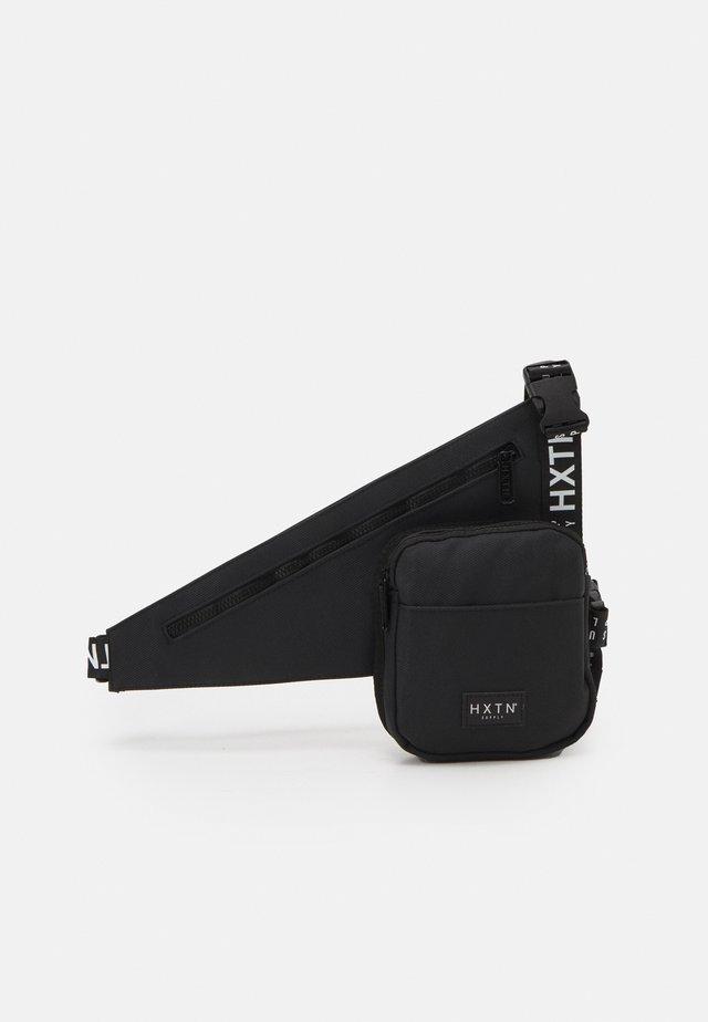 PRIME HOLSTER UNISEX - Across body bag - black