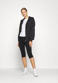 Calvin Klein Jeans - MILANO CAPRI PANT - Shorts - black - 1