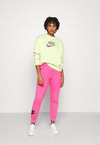 Nike Sportswear - AIR PANT   - Tracksuit bottoms - pinksicle/black - 1