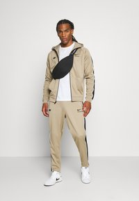 Nike Sportswear - PANT - Verryttelyhousut - khaki/black/white - 1