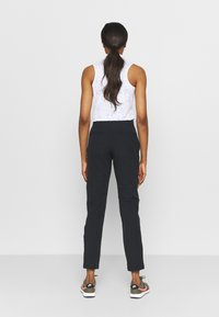 Under Armour - LINKS PANT - Trousers - black - 2