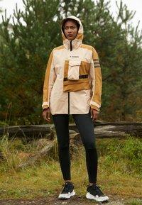 adidas Performance - TERREX XPLORIC RAIN - Hardshell jacket - halo blush/mesa - 2