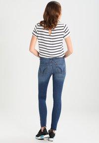 Hollister Co. - STRECH HIGH RISE SUPER SKINNY  - Jeans Skinny Fit - medium wash - 2