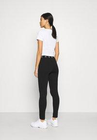 Calvin Klein Jeans - MILANO TRIM - Leggings - Trousers - black - 2