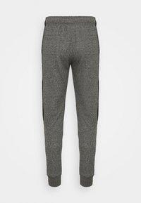 Champion - TAPE PANTS - Tracksuit bottoms - black/dark grey melange - 5