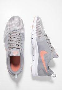 Nike Performance - WMNS NIKE FLEX ESSENTIAL TR - Sports shoes - atmosphere grey/pink quartz/echo pink/vast grey/white - 1