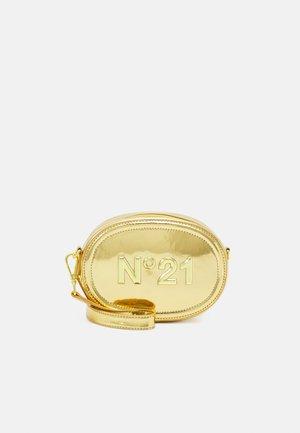 Taška spříčným popruhem - gold