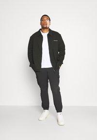 Calvin Klein - JACKET - Zip-up sweatshirt - black - 1