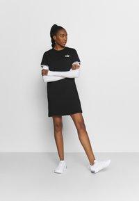 Puma - Robe en jersey - black - 1