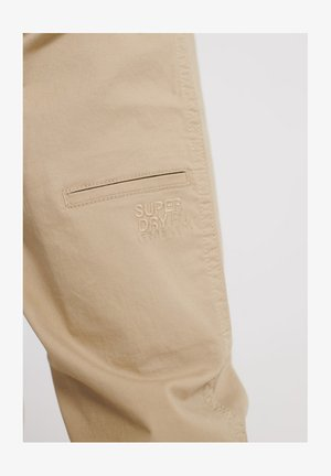 WORLDWIDE - Trousers - grain khaki