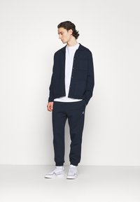 K-Way - ANDRE UNISEX - Trousers - navy - 1