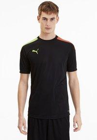 Puma - FTBLNXT - T-shirt print - black-nrgy peach-fizzy yellow - 0