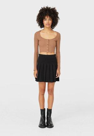 MIT KELLERFALTEN - A-line skirt - black