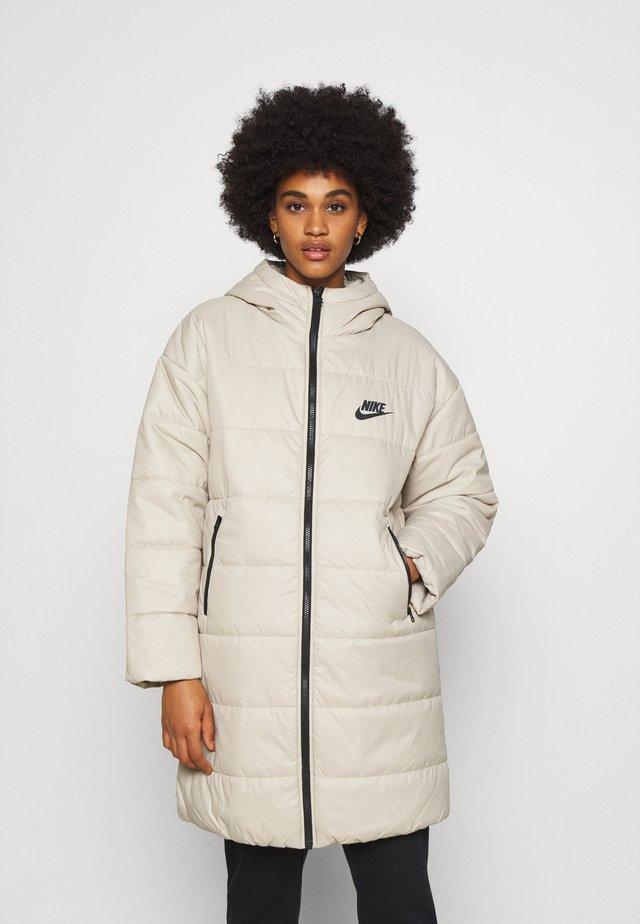 CORE - Winter coat - stone/white