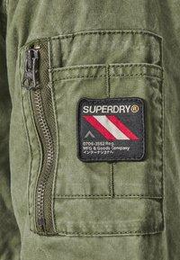 Superdry - CLASSIC ROOKIE JACKET - Light jacket - army - 5