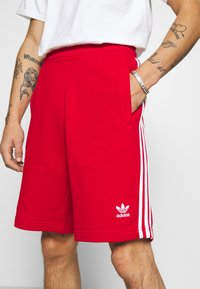 adidas Originals - 3-STRIPE UNISEX - Tracksuit bottoms - red - 3
