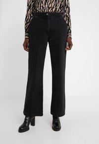 Bruuns Bazaar - ALLESIA MENELLE PANT - Flared Jeans - black - 0