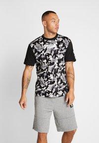 Puma - REBEL CAMO TEE - Print T-shirt - black - 0