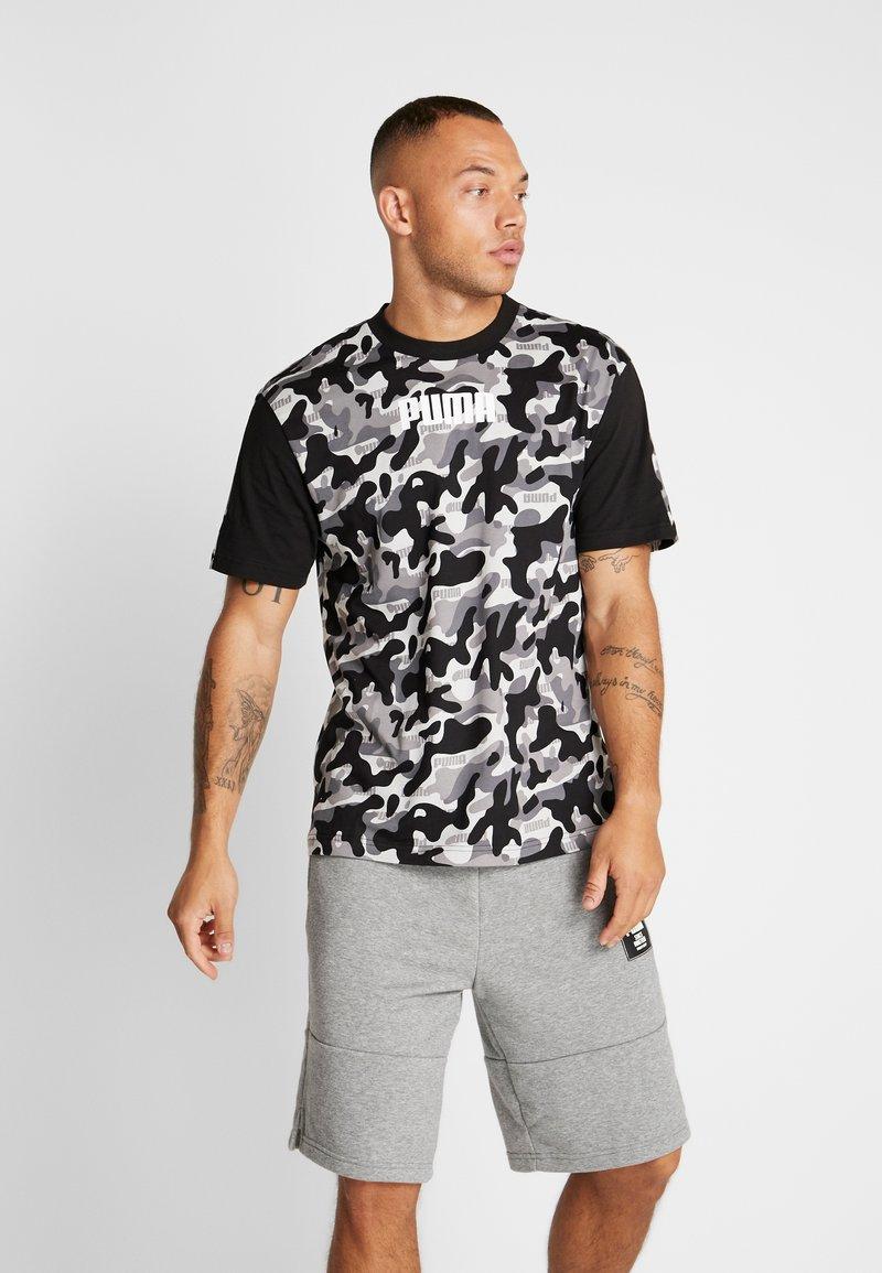 Puma - REBEL CAMO TEE - Print T-shirt - black