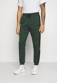Nike Sportswear - Tracksuit bottoms - galactic jade/sequoia/galactic jade/sequoia - 0