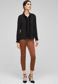 s.Oliver BLACK LABEL - MET GEPLOOIDE VOLANTS - Button-down blouse - black - 1