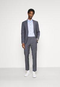 Tommy Hilfiger Tailored - FLEX SLIM FIT SUIT - Suit - grey - 1